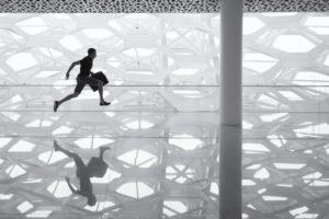 man-running-with-briefcase